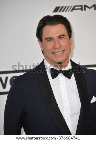 ANTIBES, FRANCE - MAY 22, 2014: John Travolta  at the 21st annual amfAR Cinema Against AIDS Gala at the Hotel du Cap d'Antibes.