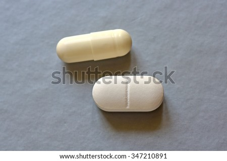 Antibiotic and probiotic, tablet and capsule.. pharmacophobia - fear of medicines. - stock photo