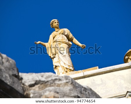 antic sculpture and the blue sky