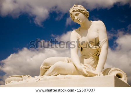 Antic statue of the nymph with a shell in Versailles, France - stock photo