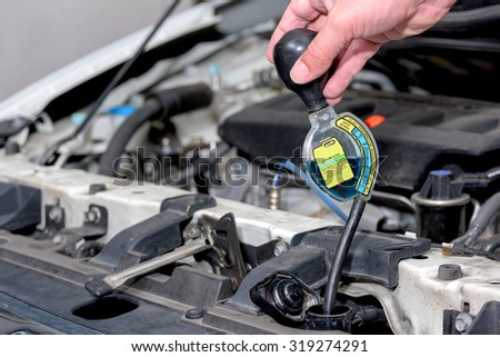 Antifreeze checker for a cars radiator