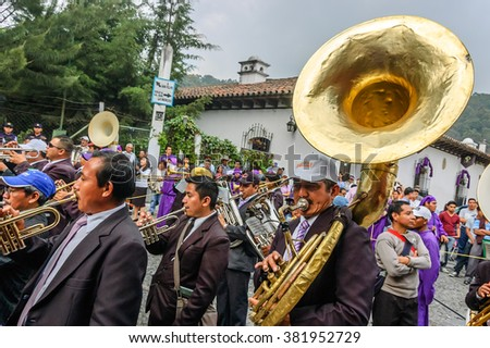 Antigua, Guatemala -  April 2, 2015: Musicians in Holy Thursday procession in Spanish colonial town & UNESCO World Heritage Site with most famous Holy Week celebrations in Latin America.