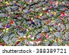 Antigua, Guatemala -  March 6, 2016: Lent carpet of flower petals on cobblestones for procession in colonial town with most famous Holy Week celebrations in Latin America. - stock photo