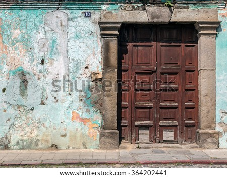 Antigua, Guatemala 2 November 2015. Exterior and beautiful ornate door of a rustic and traditional colonial building in Antigua, Guatemala. Travel Background.