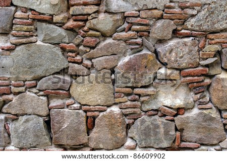 Antiguo muro de piedra - stock photo