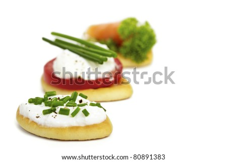 Antipasti biscuits with curd, tomato and salmon - stock photo