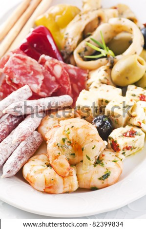 Antipasti plate with seafood and dry sausages