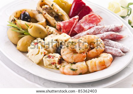 Antipasti with seafood and feta cheese - stock photo
