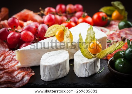 Antipasto and catering platter with different appetizers - stock photo
