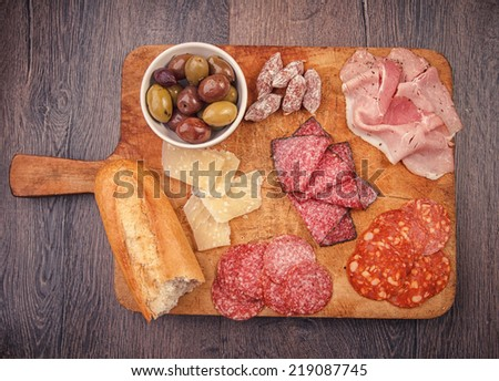 Antipasto catering platter with salami and olives - stock photo
