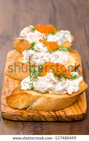 Antipasto Crostino with caviar, curd and smoked salmon