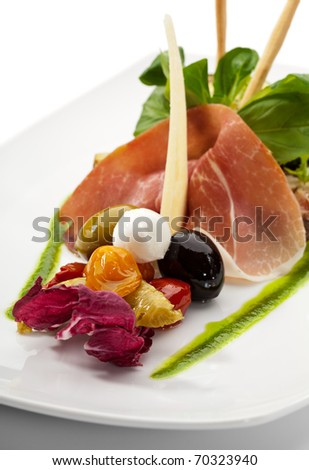 Antipasto - Italian meal. Includes Cured Meat, Artichoke, Parmesan Cheese, Olives and Zucchini - stock photo