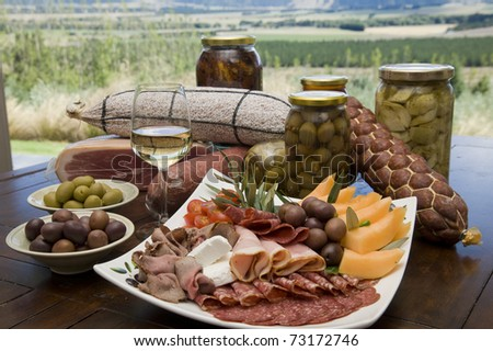 antipasto plate with scenic background