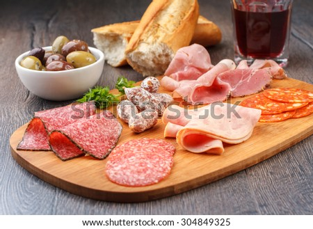 Antipasto with salami, cheese, bread and olives  - stock photo