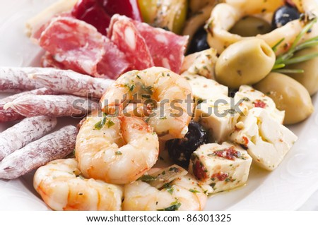Antipasto with seafood and dry sausages - stock photo
