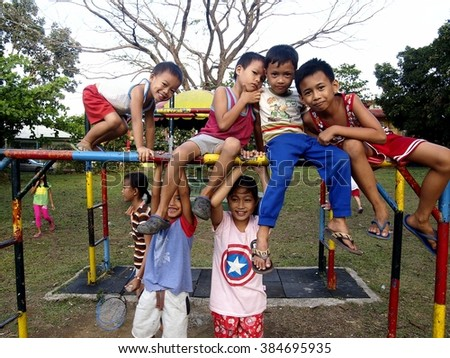 ANTIPOLO CITY, PHILIPPINES - FEBRUARY 8, 2016: Young boys and girls playing at a playground in Antipolo City, Philippines - stock photo