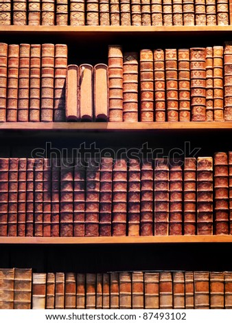 Antiquarian books, collection of old books in bookshelf - stock photo