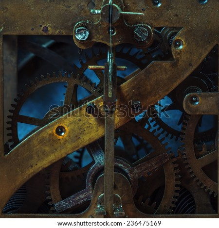 Antiquarian metal clockwork with gears - stock photo