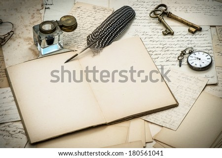 antique accessories, old letters, inkwell and vintage feather ink pen. nostalgic style background - stock photo