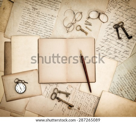 Antique accessories, old letters, pocket watch and keys. Vintage nostalgic background. Retro style toned picture - stock photo
