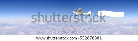 Antique Airplane with advertise board banner fly on Cityscape bird eye view with blue sky, Bangkok Thailand.