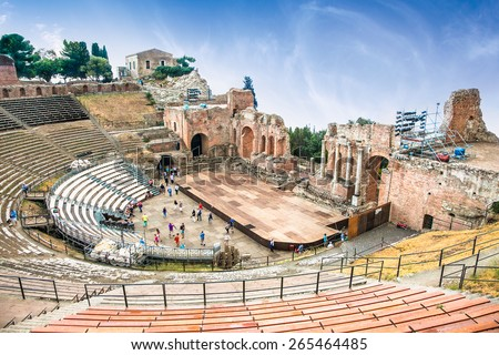 Antique amphitheater Teatro Greco in Taormina, Sicily,Italy.It is one of the most celebrated ruins in Sicily. - stock photo