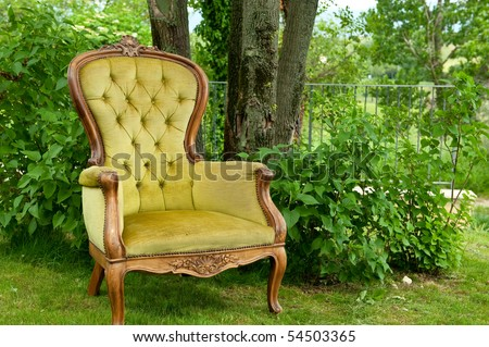 Antique armchair in green - stock photo