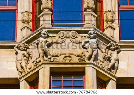 Antique balcony with four cherubs. Market square, Wroclaw - stock photo