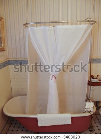 Antique bath tub with a shower liner