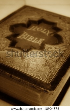 Antique Bible in sepia tones. - stock photo