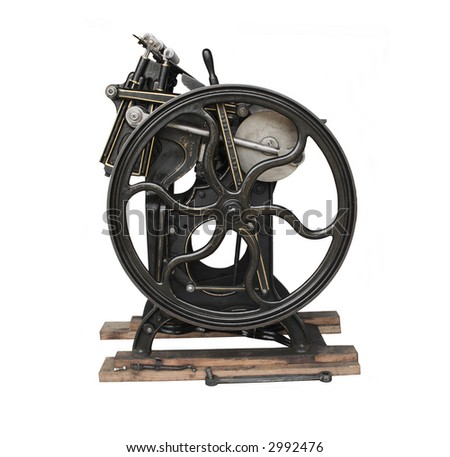antique black printing press with gold trim, isolated on white - stock photo