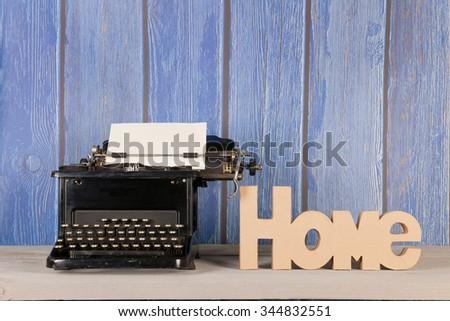 Antique black typewriter in interior - stock photo