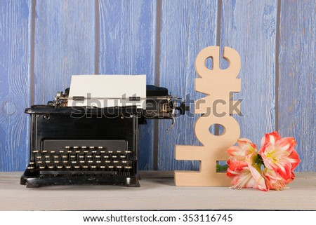 Antique black typewriter in interior at home - stock photo
