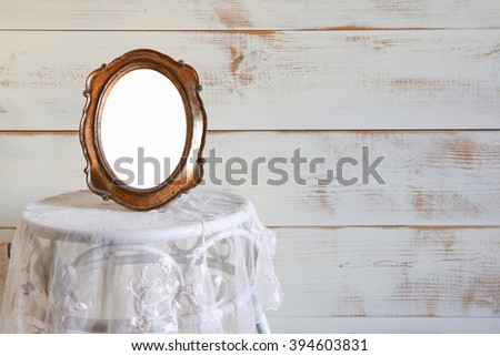 Antique blank vintage style frame on vintage table. template, ready to put photography. vintage filtered  - stock photo