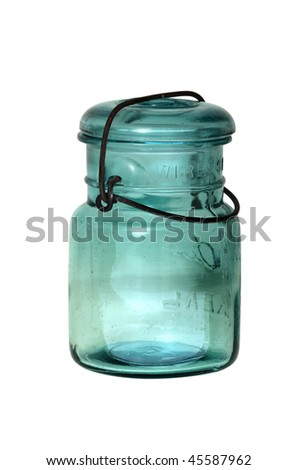Antique blue canning jar with wire secured glass top.  Commonly referred to as Mason Jars, regardless of the actual manufacturer. - stock photo