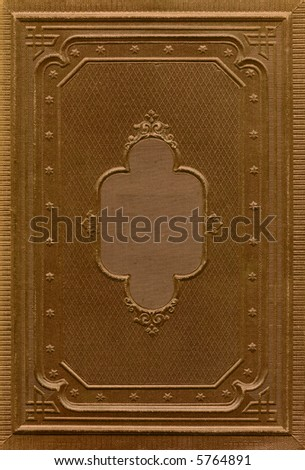 Antique book cover with a frame relief