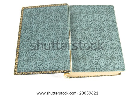 Antique book open to display inside cover with classic pattern - stock photo