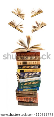 Antique book stack and books flying away  isolated on white background - stock photo
