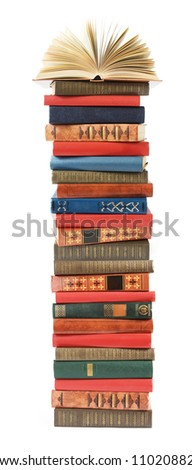Antique book stack with open book on the top isolated on white background - stock photo
