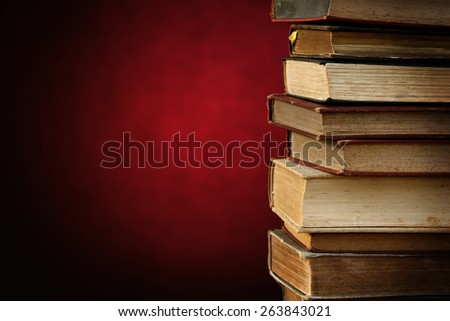 antique books on elegant red background. with space for your text. - stock photo
