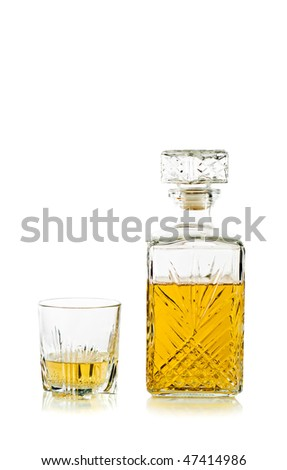Antique bottle of whiskey / scotch and glass on white - stock photo