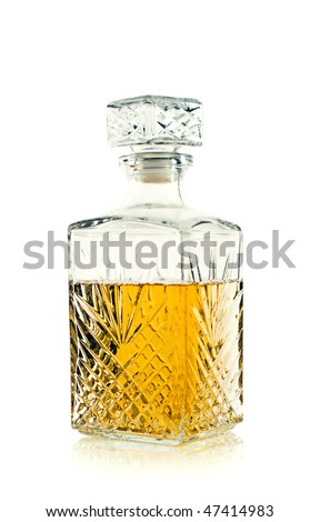 Antique bottle of whiskey / scotch on white - stock photo