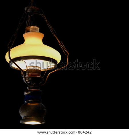 Antique brass lamp. Isolated on a black background. - stock photo