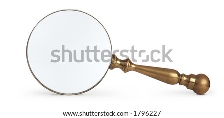 antique brass magnifying glass on white background - stock photo