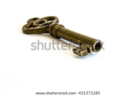 Antique Brass Skeleton Key facing in closeup on a white background