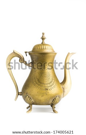 Antique brass teapot isolated on white