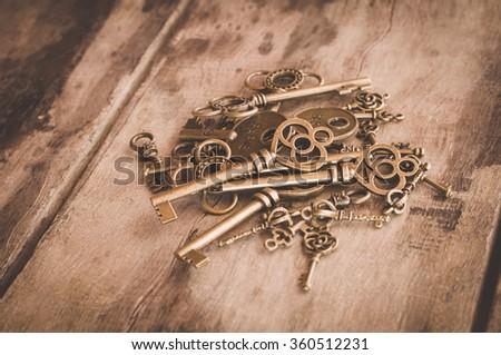 Antique Bronze Plated Heart Shaped Mini Key Charm Pendant Fit Vintage - stock photo