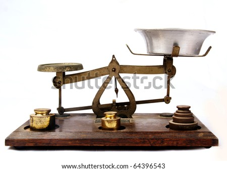 Antique bronze scale on a wooden base isolated on a white background - stock photo