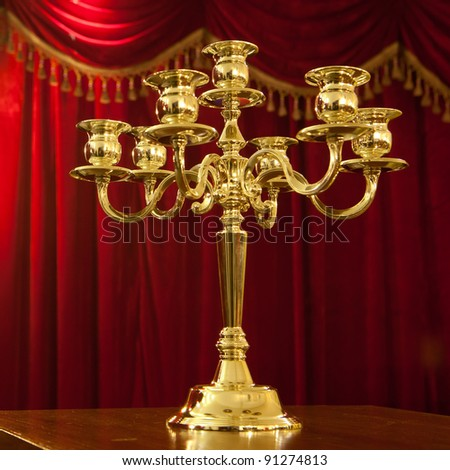 Antique candelabra with red background