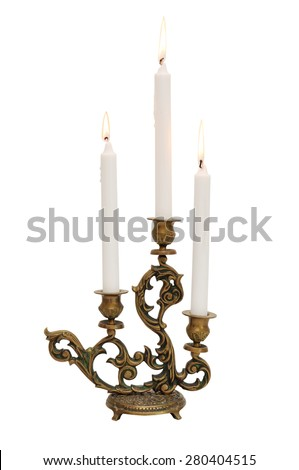 Antique candelabra with three melting candles isolated on white background - stock photo